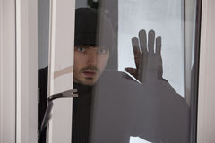 Burglar Looking Into The Window Royalty Free Stock Image