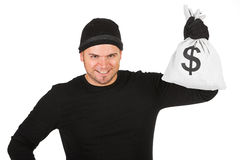 Burglar: Man Holding Bag of Cash. Series with Caucasian male as a burglar or thief, sneaking in a window, carrying stolen goods, etc.  Isolated on white Royalty Free Stock Photo