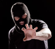 Burglar in mask. Robbing and catching something by hand Stock Images