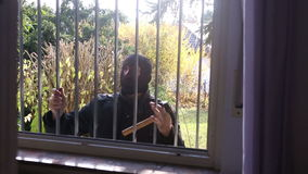 Burglar with mask trying to get into a window stock video footage