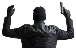 Burglar masked with balaclava is putting hands up and gives up. Isolated on white background stock photography