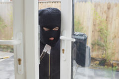 Burglar opening the door Royalty Free Stock Photos