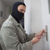 Burglar opening a door. On a private home stock photography