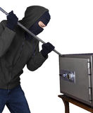 A burglar is opening safety box. A burglar with a crowbar is trying to open a safety box Royalty Free Stock Photo