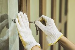 Burglar with passkey tools breaking and entering into a house. Close up Royalty Free Stock Photos