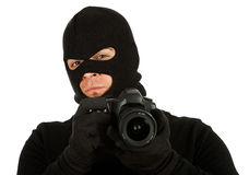 Burglar: Photographer Criminal Looks to Camera. Series with Caucasian male as a burglar or thief, sneaking in a window, carrying stolen goods, etc.  Isolated on Royalty Free Stock Images