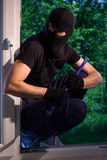 Burglar ready to break Stock Image