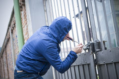 Burglar residential building Royalty Free Stock Image