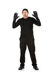 Burglar: Robber with Hands Up. Series with Caucasian male as a burglar or thief, sneaking in a window, carrying stolen goods, etc.  Isolated on white background Royalty Free Stock Photos