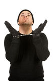 Burglar: Robber Wearing Handcuffs. Series with Caucasian male as a burglar or thief, sneaking in a window, carrying stolen goods, etc.  Isolated on white Stock Photography