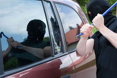 The burglar smash the glass of the car Stock Images
