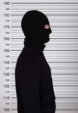 Burglar Standing Against Police Lineup Stock Images