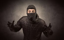 Burglar with tool. Burglar standing in black clothes and balaclava on his head royalty free stock images