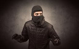 Burglar with tool. Burglar standing in black clothes and balaclava on his head stock images