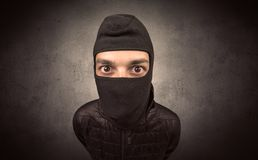 Burglar with tool. Burglar standing in black clothes and balaclava on his head royalty free stock photos