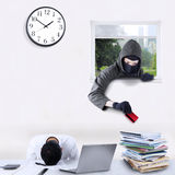 Burglar stealing credit card in office Stock Photos