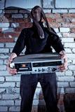 Burglar stealing electronics Stock Image