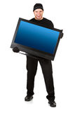 Burglar: Stealing a Modern Television. Series with Caucasian male as a burglar or thief, sneaking in a window, carrying stolen goods, etc.  Isolated on white Royalty Free Stock Photos