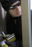 Burglar Stealing Money Stock Photography