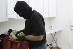 Burglar Stealing Money From House Stock Photos