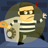 Burglar. A burglar stealing money from safe Stock Image
