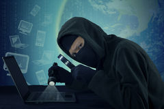 Burglar stealing user data on the laptop Stock Photos