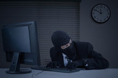 Burglar takes information in office Stock Images