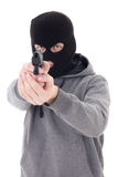 Burglar or terrorist in black mask shooting with gun isolated on Stock Photo