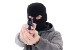 Burglar or terrorist in mask shooting with gun isolated on white Royalty Free Stock Photos