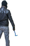 Burglar or thief from behind holds crowbar in hand. Rear view. Royalty Free Stock Image