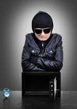 Burglar. Thief burglar during home safe codebreaking royalty free stock images