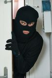 Burglar thief at house breaking Royalty Free Stock Image