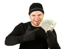 Burglar: Thief with Money Fan. Series with Caucasian male as a burglar or thief, sneaking in a window, carrying stolen goods, etc.  Isolated on white background Royalty Free Stock Photos