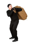 Burglar: Thief Tries to Get Away with Burlap Sack. Series with Caucasian male as a burglar or thief, sneaking in a window, carrying stolen goods, etc.  Isolated Stock Images
