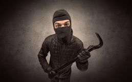Burglar with tool. Royalty Free Stock Photo