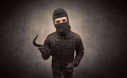 Burglar with tool. Stock Image