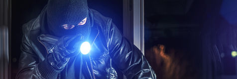 Burglar with torch royalty free stock photography