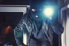 Burglar with torch Royalty Free Stock Photos
