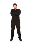 Burglar: Tough Guy Robber Thief. Series with Caucasian male as a burglar or thief, sneaking in a window, carrying stolen goods, etc.  Isolated on white Royalty Free Stock Photography