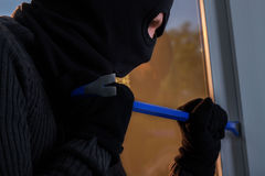 Burglar trying to break into the building. Stock Images