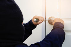 Burglar trying to break into a house. With screwdriver royalty free stock photography
