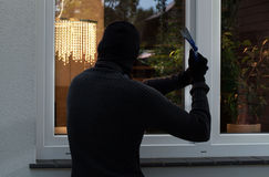 The burglar trying to break Stock Photo