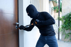 Burglar trying to force a door lock Royalty Free Stock Image
