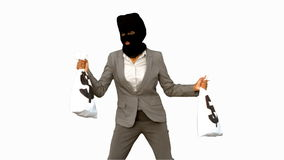 Burglar wearing balaclava and holding money bags on white screen Stock Image