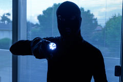 Burglar wearing a balaclava Royalty Free Stock Photos
