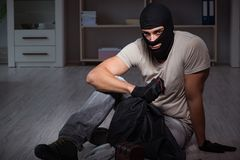 The burglar wearing balaclava mask at crime scene. Burglar wearing balaclava mask at crime scene Royalty Free Stock Image