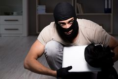 The burglar wearing balaclava mask at crime scene. Burglar wearing balaclava mask at crime scene Stock Photography
