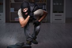 The burglar wearing balaclava mask at crime scene. Burglar wearing balaclava mask at crime scene Stock Images