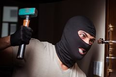 The burglar wearing balaclava mask at crime scene. Burglar wearing balaclava mask at crime scene Stock Photo