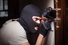 The burglar wearing balaclava mask at crime scene. Burglar wearing balaclava mask at crime scene stock image